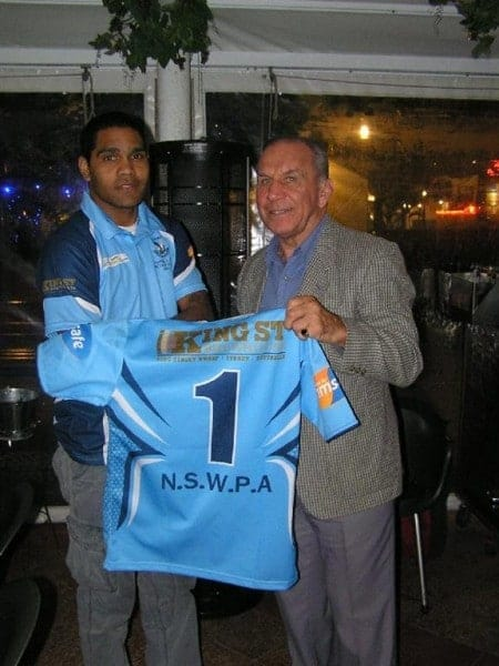 Special Guest John Sattler presents the NSWPRL team with their game day playing jumpers, here, Fullback Brenton Chochran, is presented with his playing jumper.