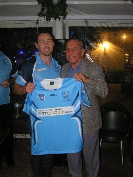 No 6, Five-eight, Clayton Parkyns is presented with his playing jumper.
