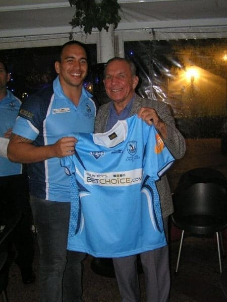No 8, Front row forward Desai Gupwell is presented with his playing jumper.